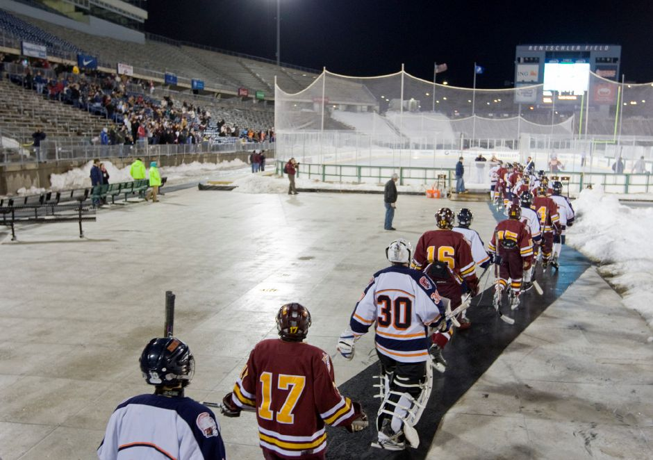 Lyman Hall and Sheehan players take to the rink together at the start of Whalers Hockey Fest at Rentschler Field in East Hartford February 14, 2011. (Dave Zajac/Record-Journal)
