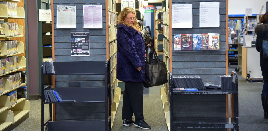 Plantsville resident Rhonda Despins looks at DVDs at the Southington Public Library, 255 Main St., on Monday, Dec. 30, 2019. The town is looking to build a new, larger library to accomodate growing needs. | Bailey Wright, Record-Journal
