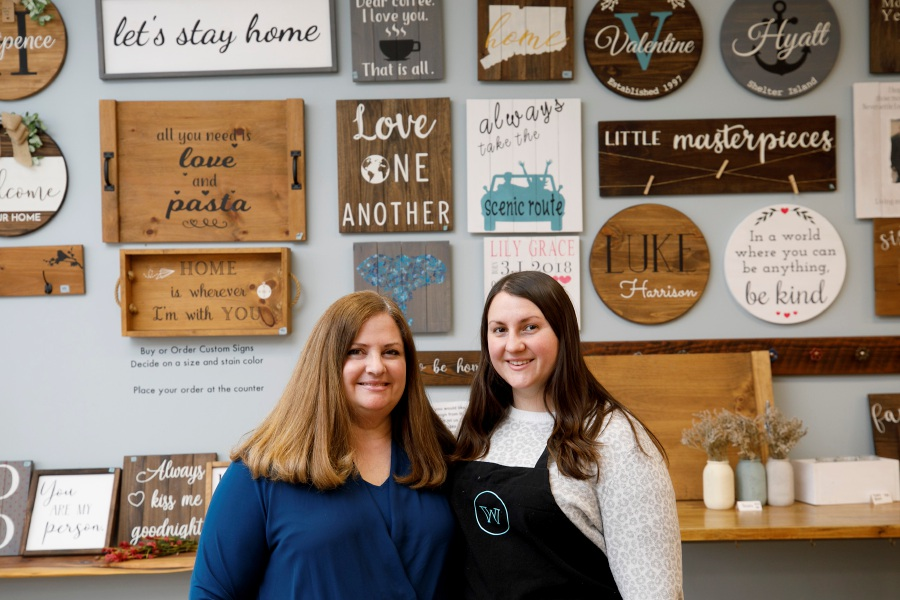 Jackie Valentine, owner of Words on Wood, left, and daughter Cassie Valentine, creative director, pose in the shop at 144 Center St. in Wallingford on Tuesday. Dave Zajac, Record-Journal