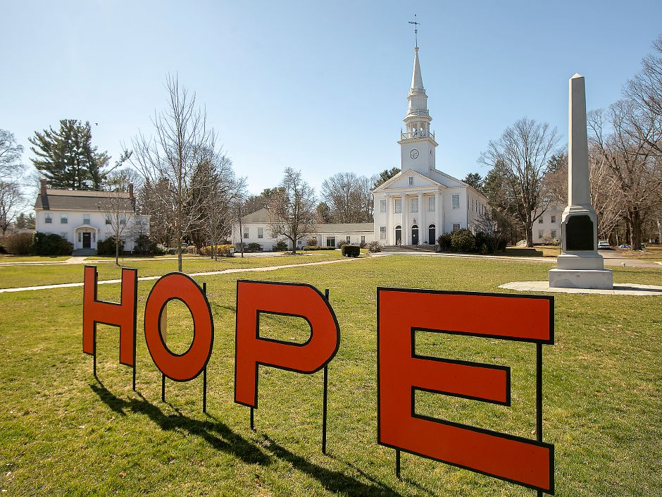 The four letters spell out a simple message Friday in front of the First Congregational Church in Cheshire. In an effort to bring the community together, residents are being asked to ring bells each night at 8 p.m. in a sign of unity amid the virus pandemic.