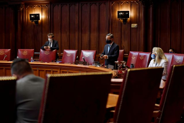 State Senators work socially distanced between one another during special session at the State Capitol, Tuesday, July 28, 2020, in Hartford, Conn. (AP Photo/Jessica Hill)