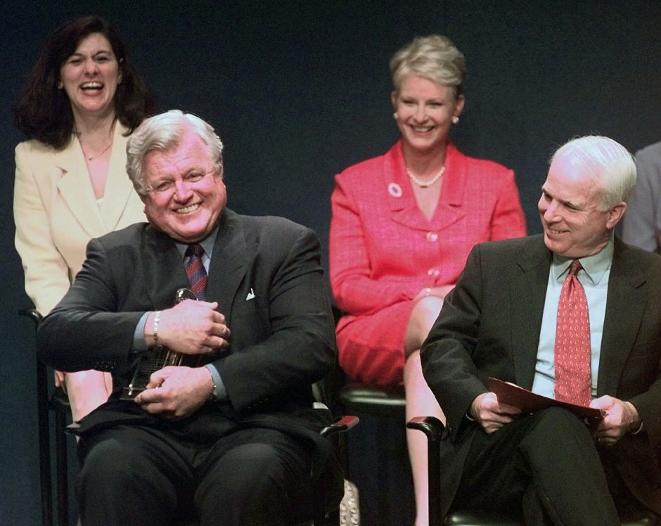 FILE -- in a May 24, 1999 file photo Senator Edward Kennedy, D-Mass., jokingly holds the Profile in Courage award lantern as if he intends to keep it, as co-winner, Senator John McCain, R-Ariz., looks on at right during ceremonies at the John F. Kennedy Library in Boston. In back row are their spouses, Victoria Kennedy, left, and Cindy McCain. Sen. Ted Kennedy has died after battling a brain tumor his family announced early Wednesday Aug. 26, 2009. (AP Photo/Elise Amendola/file)