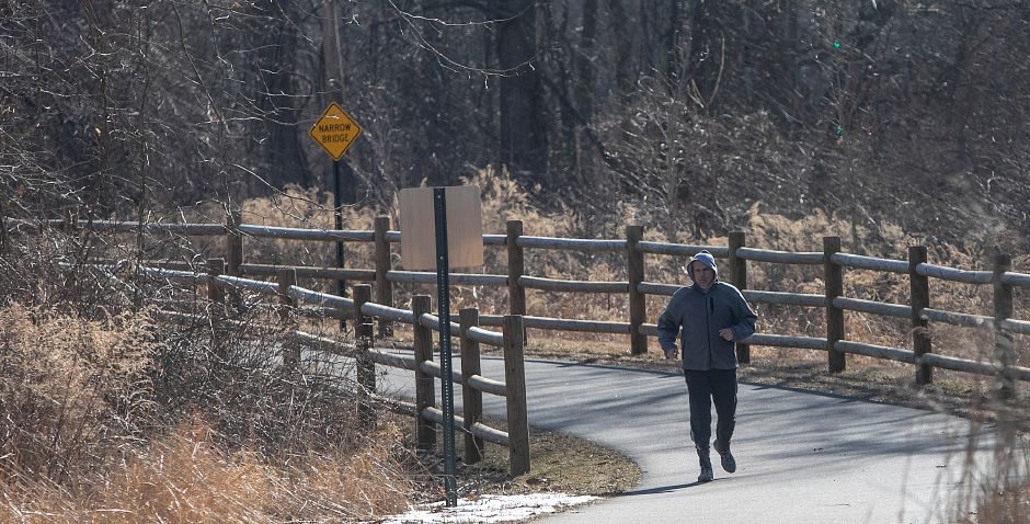 Wilfredo Cruz, of Wallingford, jogs on the Quinnipiac River Linear Trail, Tues., Feb. 26, 2019.  Work on a paved recreational trail from the Wallingford Senior Center to the Community Lake area is expected to start in April. Dave Zajac, Record-Journal