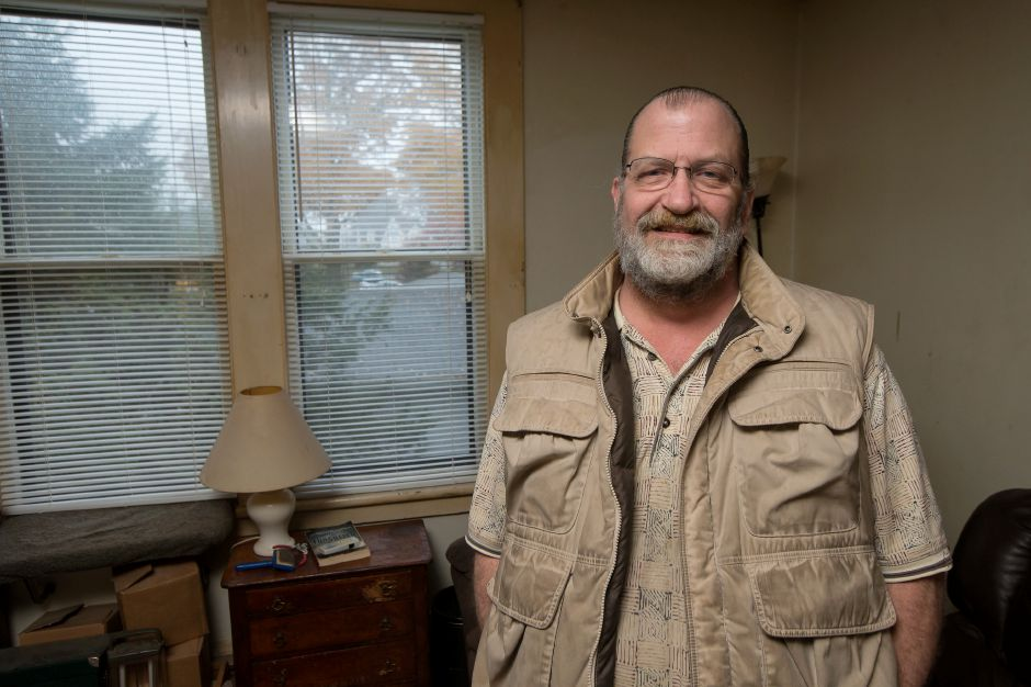 James McCorkle stands for a portrait Friday at his home in Southington. He has relied on the town's senior bus service for doctor visits and filling his medical marijuana prescription at a dispensary in Bristol. Justin Weekes, special to the Record-Journal