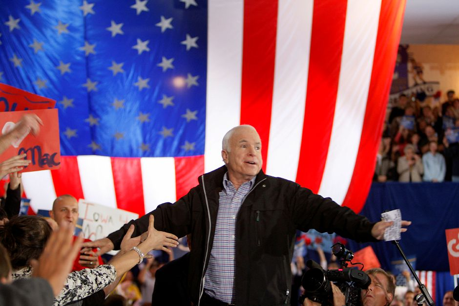 Republican presidential candidate Sen. John McCain, R-Ariz., greets supporters as he enters a campaign rally at the University of Northern Iowa in Cedar Falls, Iowa, Sunday, Oct. 26, 2008. (AP Photo/Stephan Savoia)