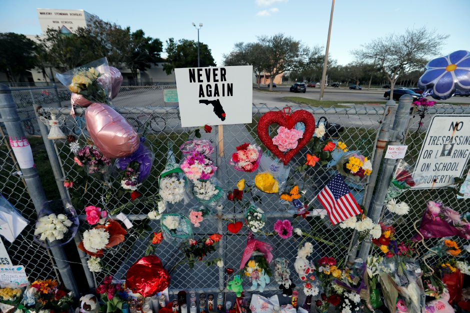 A makeshift memorial is seen outside the Marjory Stoneman Douglas High School, where 17 students and faculty were killed in a mass shooting on Wednesday, in Parkland, Fla., Monday, Feb. 19, 2018. Nikolas Cruz, a former student, was charged with 17 counts of premeditated murder on Thursday. (AP Photo/Gerald Herbert)