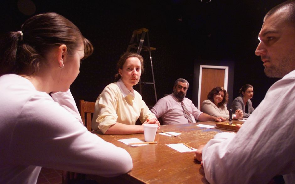 "Tracey Brown, left, and her brother Scott Brown, right, with Jennifer Glover, center, and the rest of the cast of ""12 Angry Jurors"" rehearse Tues., Oct. 5 1999 at the Castle Craig Playhouse."