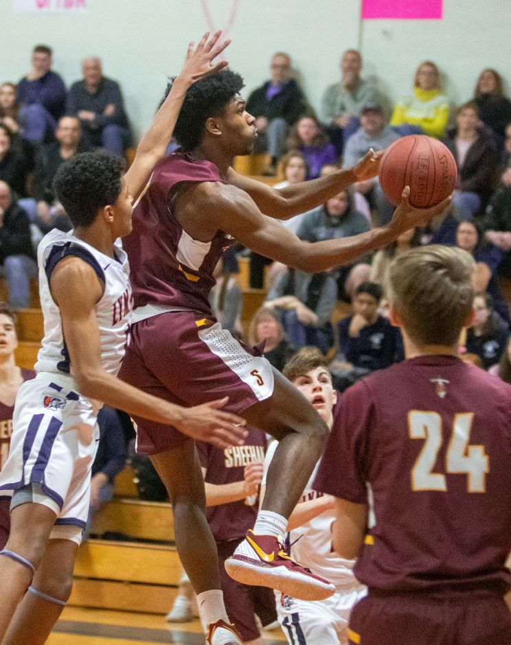 Sheehan's Kris Jackson had a game-high 20 points in Thursday's first-round SCC Tournament game at Xavier. The No. 7 Falcons pulled away late for a 62-52 win over the No. 10 Titans. | Aaron Flaum, Record-Journal