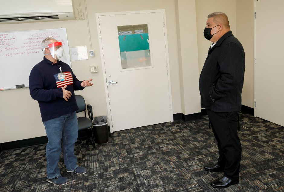 Paul Shaker, a licensed clinical social worker, talks with Hipolito Villanueva, of Meriden, at Rushford in Meriden on March 5. Dave Zajac, Record-Journal