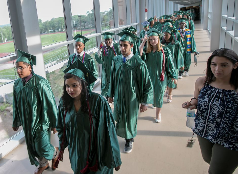The procession continues as graduates walk the bridge to graduation ceremonies at Maloney High School in Meriden, Tuesday, June 13, 2017. | Dave Zajac, Record-Journal