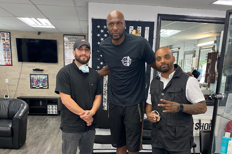 Eric Soto, left, former NBA star Lamar Odom and Trey Maestri pose for a photo on Wednesday afternoon at Trey