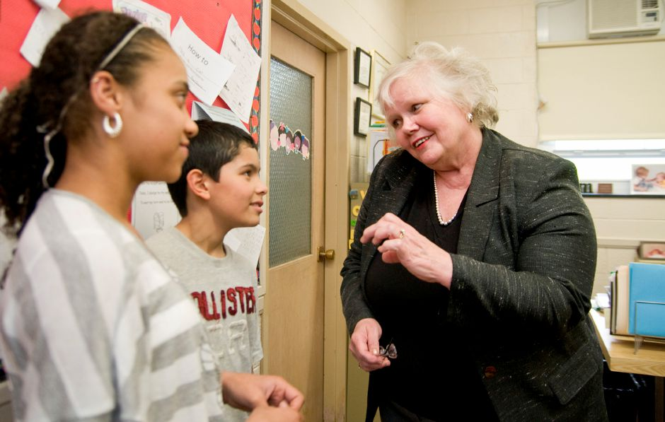 Principal Karen Smith chats with student council members Jada Amador, left, and Daniel Mendoza, center,  at Derynoski School in 2011. Smith died last month after battling ovarian cancer. See more file photos online at myrecordjournal.com Record-Journal file photo