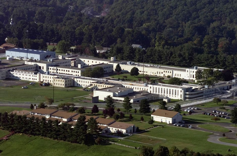 In this Sept. 23, 2004 photo, an aerial view of the Danbury Connecticut Federal Correctional Institute is shown. On Tuesday, May 12, 2020, a federal judge in Connecticut ordered officials at the facility to speed up the process of moving inmates to home confinement to protect them from the coronavirus. (AP Photo/Douglas Healey, File)