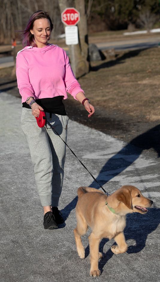 Jessica Majewicz, of Southington, walks dog, Cooper, on the Farmington Canal Heritage Trail during a warm winter afternoon in Southington, Mon., Feb. 4, 2019. Dave Zajac, Record-Journal