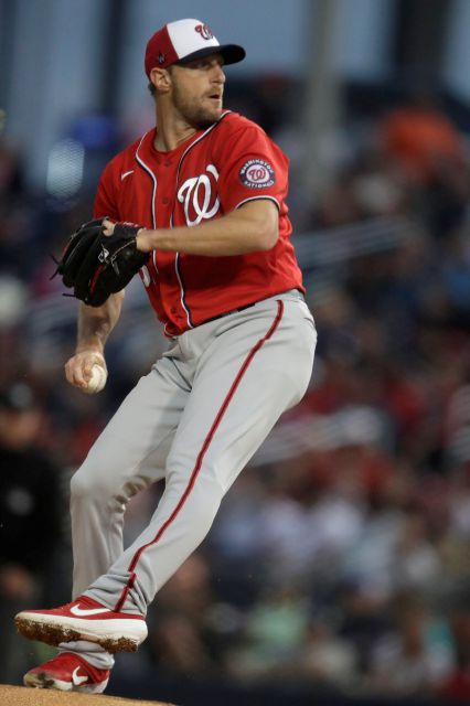 Washington Nationals starting pitcher Max Scherzer (31) works in the first inning of a spring training baseball game against the Houston Astros Saturday, Feb. 22, 2020, in West Palm Beach, Fla. (AP Photo/John Bazemore)
