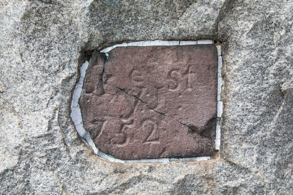 A cornerstone embedded in a monument marking the location of the Old Stagecoach Tavern built in 1752 at the corner of East Main and Broad Streets in Meriden, Friday, May 12, 2017. A Harwinton developer has filed site plans with the city to build a 7,000-square foot O'Reilly Auto Parts Store on the lot. | Dave Zajac, Record-Journal