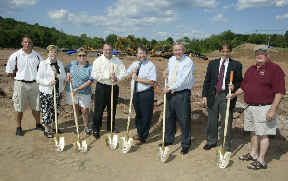 From left, John Ferrazzi, a football coach, Mary Fritz, State Representative, Judy Samaha, athletic director, Vincent Testa, town councilor, Tom Hennessey, Walingford Board of Education, Ken Henrici, superintendent, Bill Dickinson, Mayor, and Charles Farley, track and field coach, stand with shovels at the ceremonial groundbreaking at Sheehan High School on June 15, 2006.