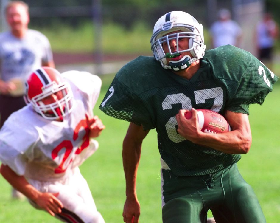 Maloney tailback Edwin Roman breaks clear during the scrimmage game on Wednesday, Sept.1 ,1999.