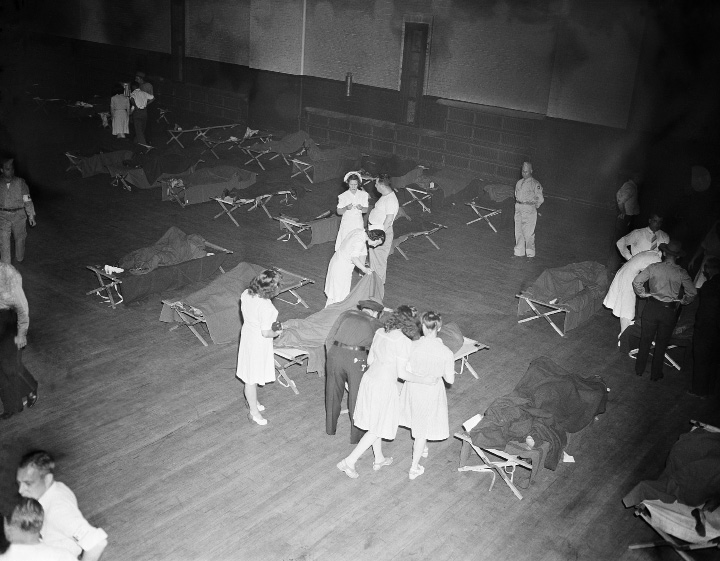 This is the makeshift morgue at the state armory in Hartford, Connecticut, following the disastrous fire at the Ringling Bros. and Barnum and Bailey circus, July 6, 1944. (AP Photo/Matty Zimmerman)
