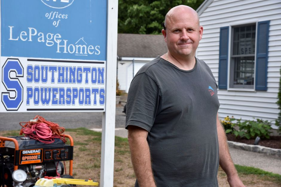 Jaime Sewell, owner of Southington PowerSports, poses outside his business at 172 Flanders St. in Southington on Monday, Aug. 10, 2020. After storm Isaias, Sewell has been loaning generators to people in need. | Bailey Wright, Record-Journal