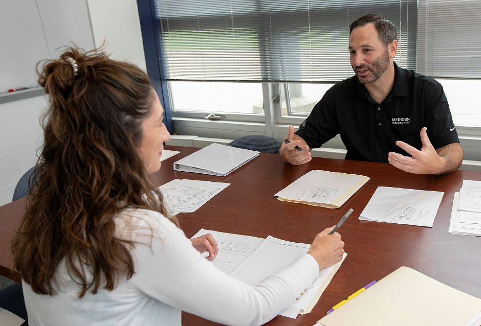 New Principal John Kuckel talks with Martha-Anne Noonan, English Dept. head, during a meeting at Lincoln Middle School, Tues., Aug. 13, 2019. Dave Zajac, Record-Journal