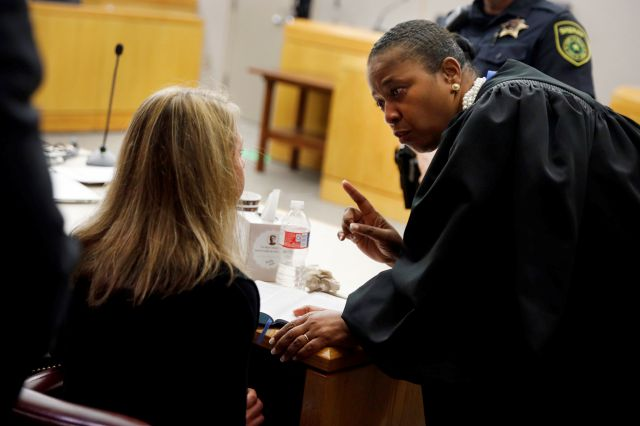 Former Dallas Police Officer Amber Guyger, left, listens to words of advice and encouragement from State District Judge Tammy Kemp after the judge had given her a Bible and before Guyger left for jail, Wednesday, Oct. 2, 2019, in Dallas. Guyger, who said she mistook neighbor Botham Jean