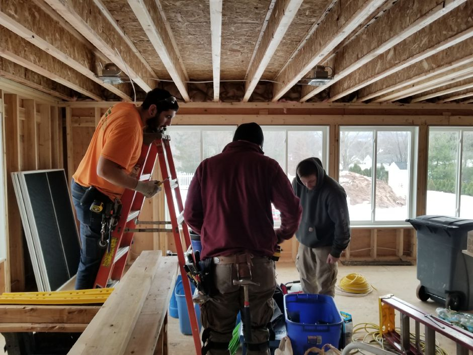 IBEW Local 90 work on the Catlin family home in Plantsville on Saturday, Jan. 20. | Photo Courtesy Ken Catlin