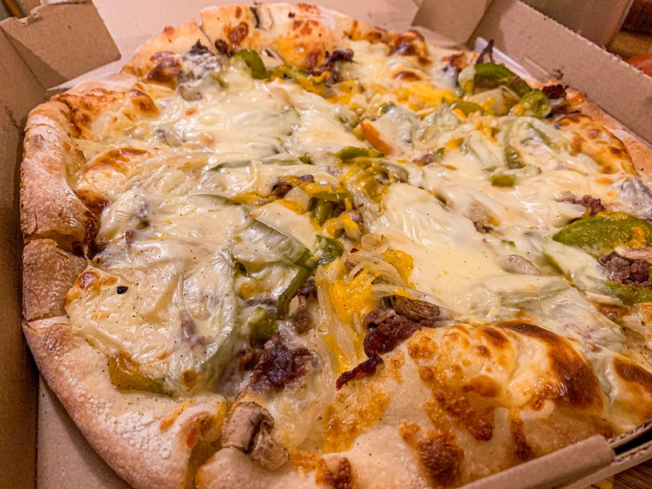 Casa di Roma's philly cheesesteak pizza is topped with mozzarella, shredded steak, peppers, onions, mushrooms and american cheese. |Lindsay Pytel, special to Record-Journal