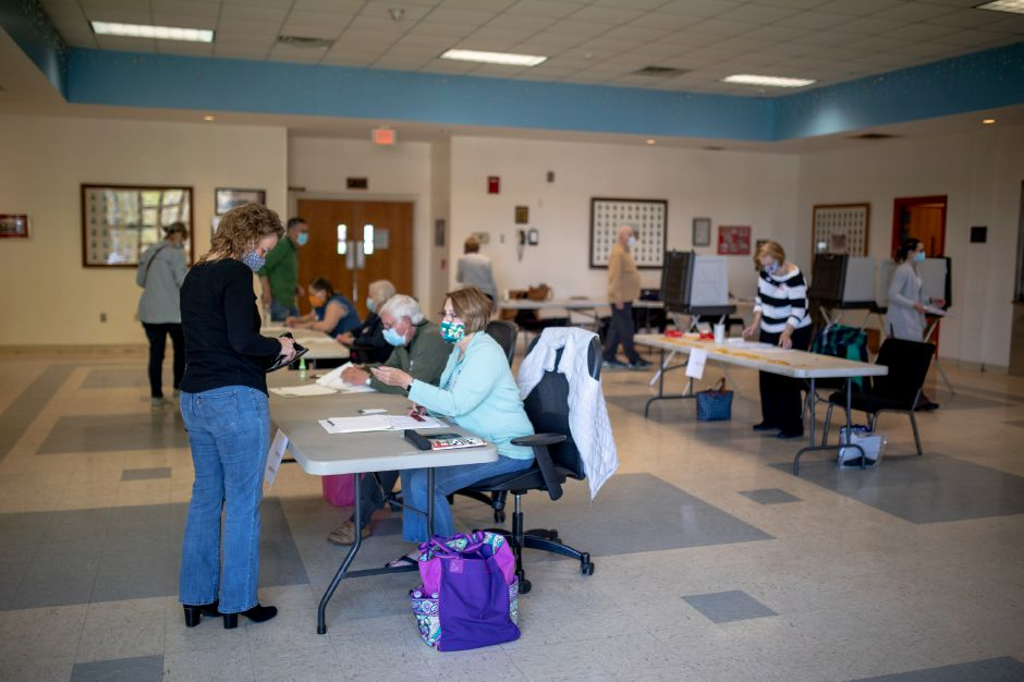 Poll workers help voters get ballots to vote on Plainville