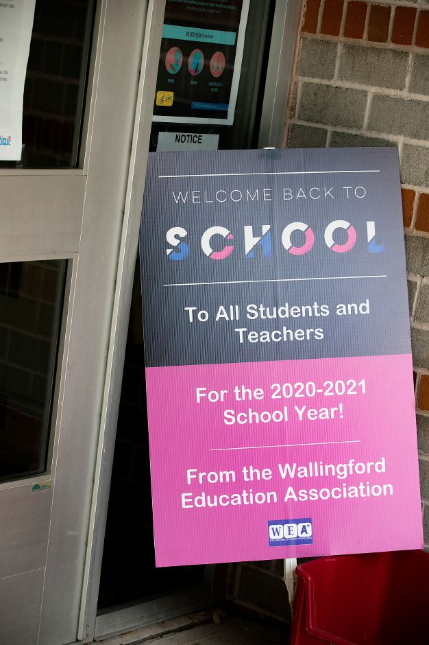 "A ""Welcome Back to School"" sign at the front entrance to Dag Hammarskjöld Middle School in Wallingford, Mon., Sept. 14, 2020."
