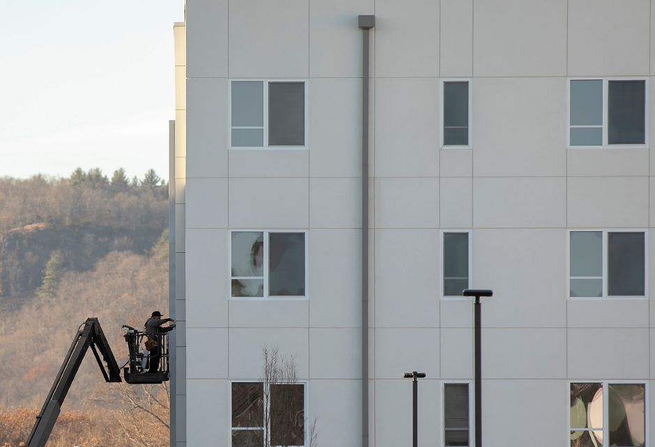 Crews finish up work on exterior windows at Meriden Commons II in Meriden, Tues., Nov. 26, 2019. Pennrose Properties and the Meriden Housing Authority will host a ribbon-cutting at Meriden Commons II on Dec. 5 to celebrate the opening of 76 new units of market rate and affordable housing. Dave Zajac, Record-Journal