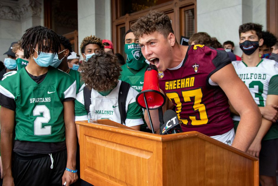 Sheehan's Jason Villano speaks to the crowd during a rally at the Connecticut State Capitol during a rally trying to reinstate a football season on Wednesday, September 9, 2020. Aaron Flaum, Record-Journal