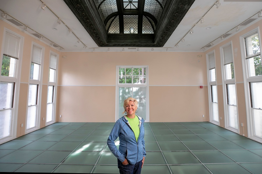Kathy Matula, recreation coordinator, stands in the main room of the Augusta Curtis Cultural Center on East Main Street in Meriden on Tuesday. The city's Parks & Recreation Department is booking and operating events after the center's board of directors dissolved earlier this summer.