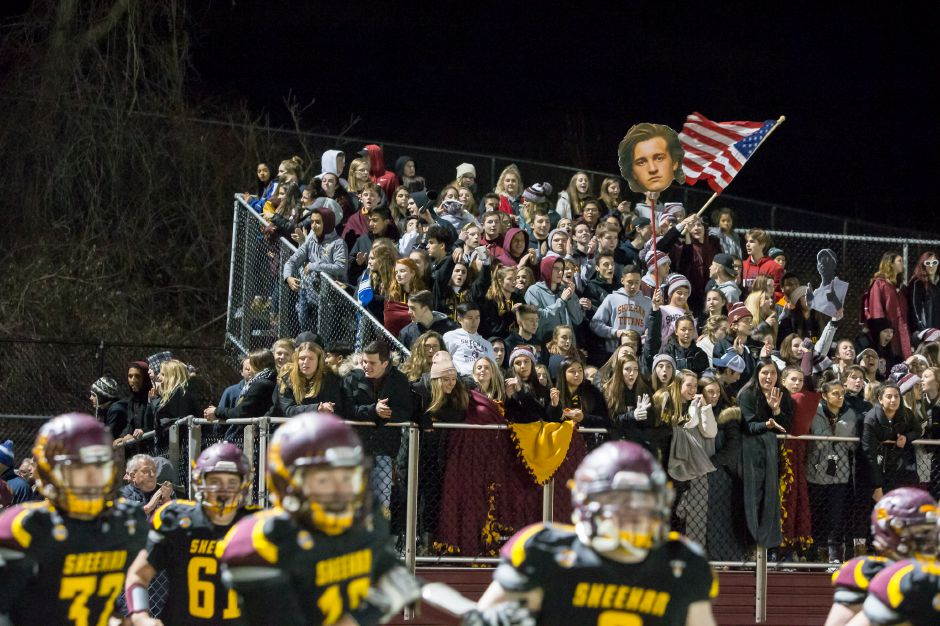 The student section cheers as the Sheehan football team charges onto Riccitelli Field for a 2018 state playoff game. How to  manage crowds in the era of COVID-19 is one of the issues the CIAC and its member schools will be addressing in the weeks to come. Record-Journal file photo