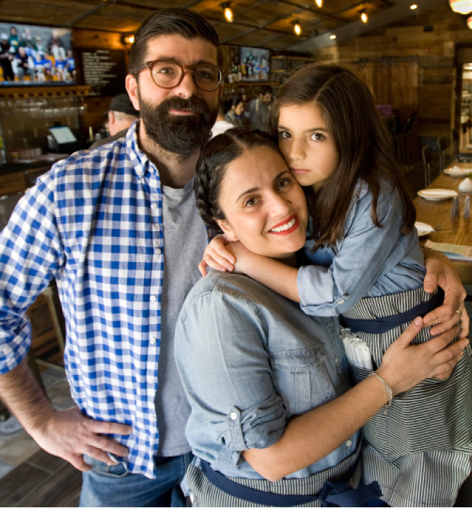 Dimitri Magriplis and his wife, Rita Halkias, owners of Cheshire Pizza & Ale, with their daughter, Kokona Magriplis, 7, in the restaurant.| Dave Zajac, Record-Journal