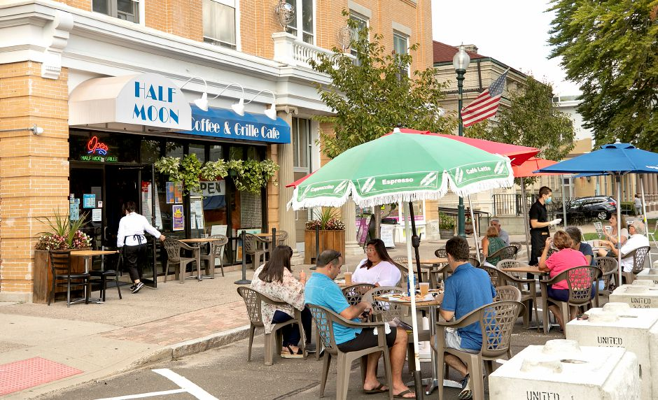 People enjoy lunch at Half Moon Coffee & Grille Cafe on North Main Street in Wallingford on Sept. 4. Outdoor dining on public sidewalks may be extended through November, giving restaurants more time to accommodate more patrons. Dave Zajac, Record-Journal