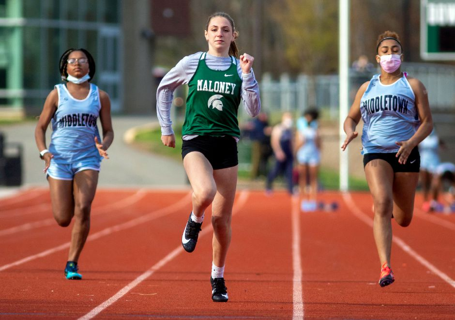Shaelyn Murphy and the Maloney Spartans swept a CCC South dual meet at Bristol Eastern on Tuesday. Murphy, seen here in an earlier meet against Middletown, won the 100 and high jump. Aaron Flaum, Record-Journal