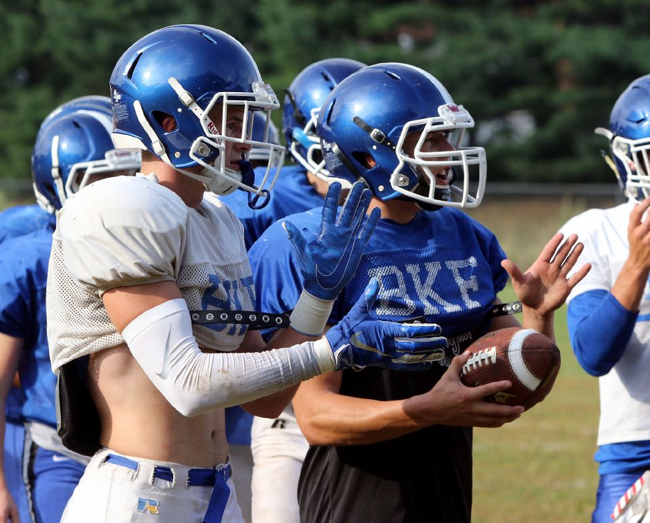 Seniors Carter Uhlman, left, and Billy Carr fire up the Blue Knights during a recent practice. Southington is looking to follow up on last year's 10-0 regular season. | Aaron Flaum, Record-Journal