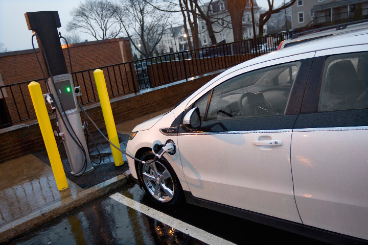 A Chevy Volt is plugged in Tuesday at an electric vehicle charging station installed in the back parking lot of the Meriden Public Library.  |  Dave Zajac / Record-Journal