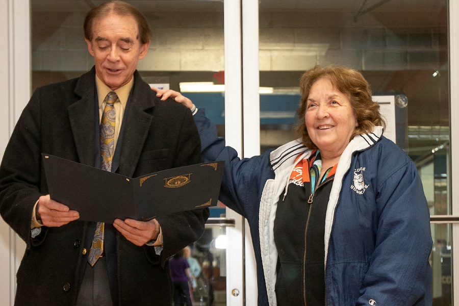 Mayor William Dickinson proclaims Monday as Phyllis Drescher Day in Wallingford during a surprise party honoring her for 50 years of service at the Wallingford YMCA west side branch, Mon., Feb. 17, 2020. Drescher has worked at the YMCA for 50 years. She is currently a water aerobics instructor, the Silver Sneakers group exercise instructor and Parkinsons water exercise instructor. Dave Zajac, Record-Journal