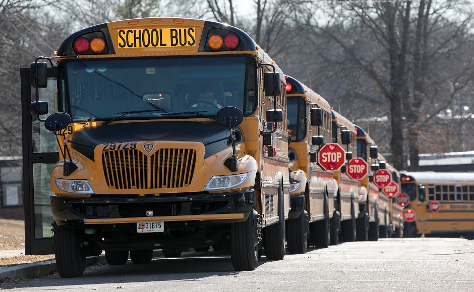 Stop signs extended on buses at Lyman Hall High School in Wallingford, Wednesday, February 28, 2018. Dave Zajac, Record-Journal