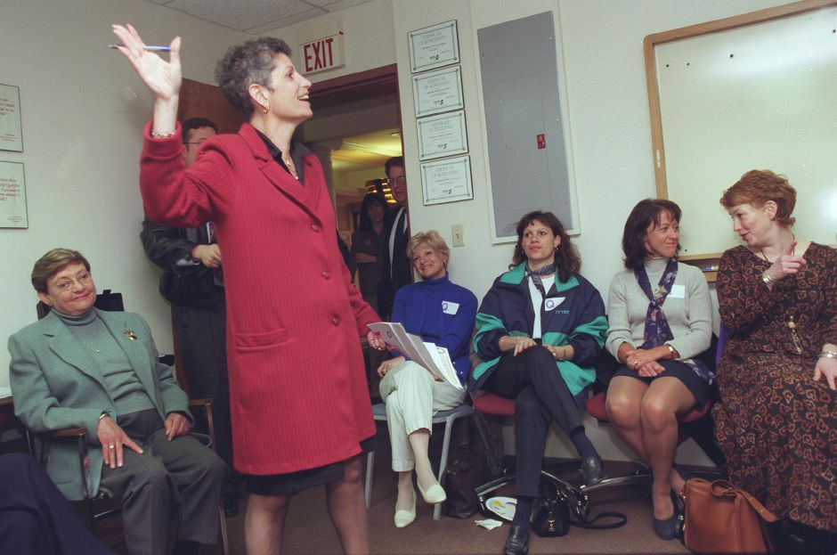 Joan Testa, a consultant for the Quinnipiac Chamber of Commerce, takes charge Mon., April 3 2000 for their membership campaign kickoff at their Center St. headquarters.