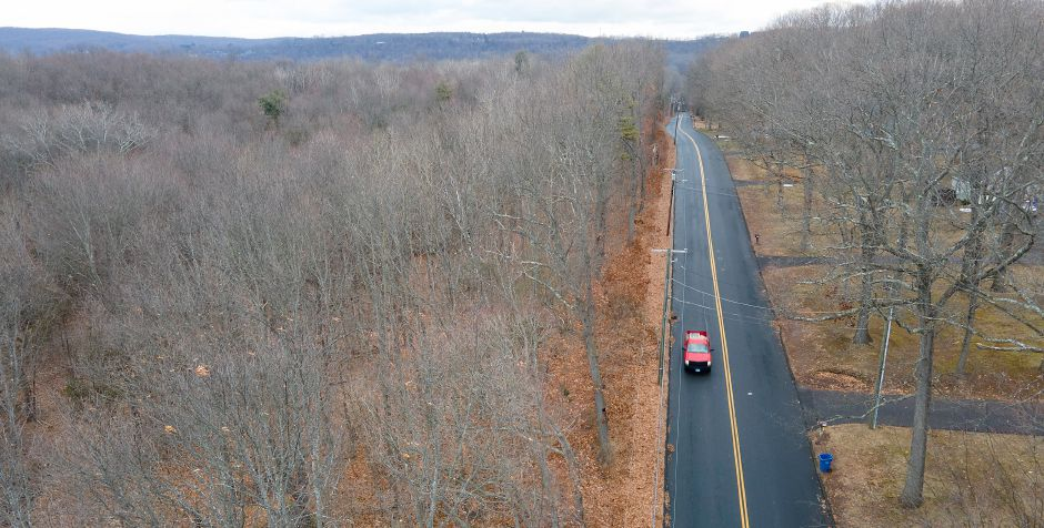 View looking east shows a wooded area, left, proposed for a housing development at 295 Laning St. in Southington on Wednesday. Dave Zajac, Record-Journal