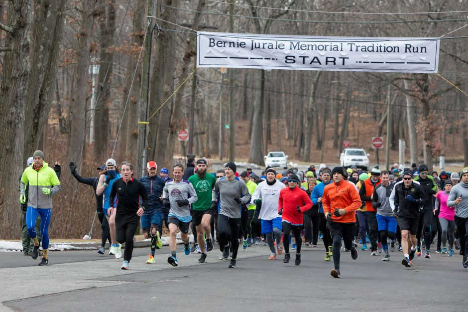 Runners leave the start Sunday during the 50th annual Bernie Jurale Memorial Tradition Run at Hubbard Park in Meriden January 27, 2019 | Justin Weekes / Special to the Record-Journal