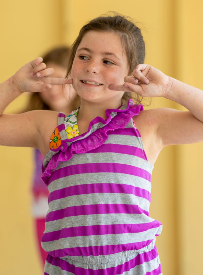 Musical theater camper Ava Perez, 7, rehearses a musical number from Annie Kids.