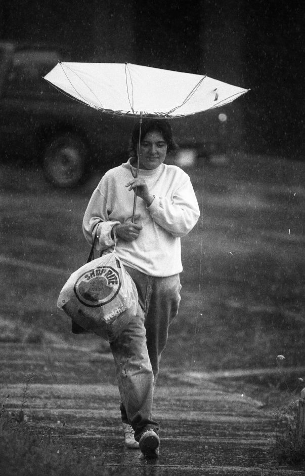 RJ file photo - Wind adds to the discomfort of the rain for Lona Demers Aug. 11, 1989. The umbrella turned upside down while walking down Crown Street in Meriden.