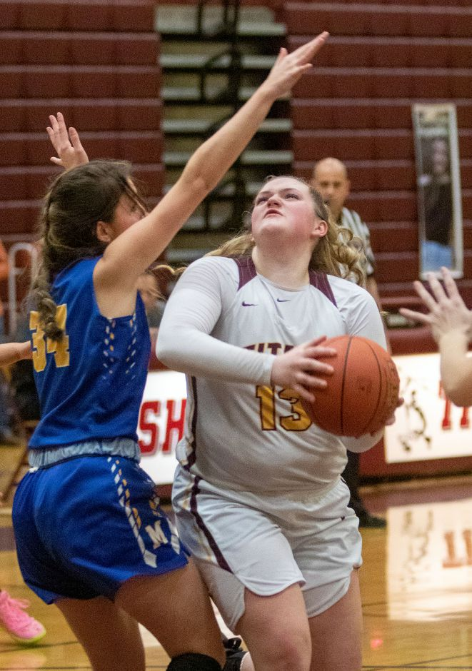Sheehan's Caitlyn Hunt gets around Mercy's Samantha Strell as she goes to the basket during the first half at Sheehan High School on Friday, February 14, 2020. Aaron Flaum, Record-Journal