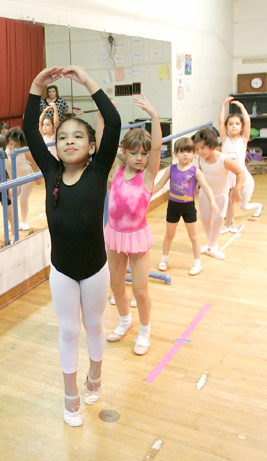 Record Journal Photo/ Johnathon Henninger 9.29.09 - Salena Gonzalez, 7, does her best at ballet dance class at Girls Inc. in Meriden Monday afternoon. Ballet teacher, Candice Kowalski was teaching the Sous-Sus in the second position.