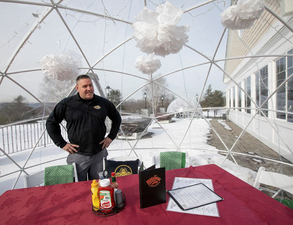 Pete McAloon, manager, talks about igloo dining at Back Nine Tavern at Southington Country Club, Thurs., Jan. 23, 2020. The restaurant features two igloos for dining on the back patio of the country club. Dave Zajac, Record-Journal