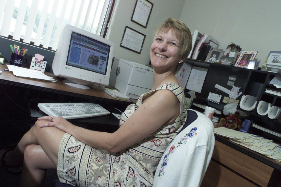 Jayne P. Huebner, of Meriden, is the office manager at Mule Security and Electric, Inc. in Meriden. She is one of several area chamber of commerce members that will be trying a website called NationJob to look for new employees for their company, Aug. 9, 2000.